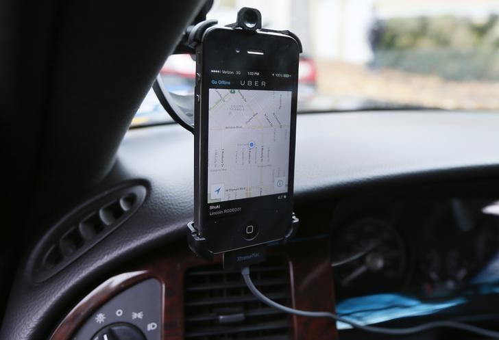 Transportation app Uber is seen on the iPhone of limousine driver Shuki Zanna, 49, in Beverly Hills, California, December 19, 2013. REUTERS/Lucy Nicholson