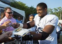 Jul 29, 2014; St. Louis, MO, USA; St. Louis Rams defensive lineman Michael Sam (96) signs autographs after practice at Rams Park. Mandatory Credit: Scott Rovak-USA TODAY Sports