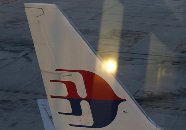 The tail wing of a Malaysia Airlines jet is seen at Kuala Lumpur International Airport July 25, 2014.  REUTERS/Olivia Harris