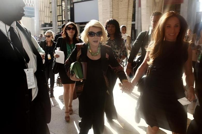 TV personality Joan Rivers and daughter Melissa Rivers leave following a Spring/Summer 2013 collection show at New York Fashion Week September 10, 2012.    REUTERS/Carlo Allegri