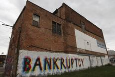 """The word """"Bankruptcy"""" is painted on the side of a building in Detroit, Michigan October 25, 2013. REUTERS/Joshua Lott"""