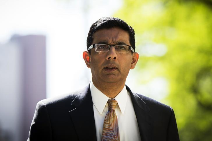 Conservative commentator and best-selling author, Dinesh D'Souza exits the Manhattan Federal Courthouse after pleading guilty in New York, May 20, 2014. REUTERS/Lucas Jackson