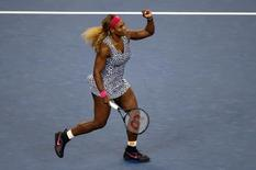 Serena Williams (USA) celebrates after recording match point against Flavia Pennetta (ITA) on day ten of the 2014 U.S. Open tennis tournament at USTA Billie Jean King National Tennis Center. Sep 3, 2014; New York, NY, USA; Jerry Lai-USA TODAY Sports