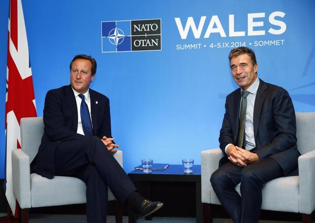 Britain's Prime Minister David Cameron (L) and NATO's Secretary General Anders Fogh Rasmussen attend a bilateral meeting at Celtic Manor golf club near Newport in Wales, September 3, 2014.  REUTERS/Andrew Winning