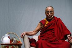 Tibetan spiritual leader the Dalai Lama looks on during a public talk at the Fraport Arena in Frankfurt May 14, 2014. REUTERS/Ralph Orlowski