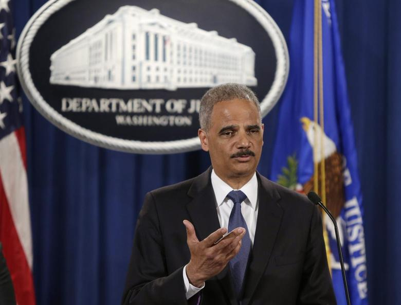 United States Attorney General Eric Holder answers a question at a news conference announcing updates in the Justice Department's investigation of the shooting of Michael Brown in Ferguson, Missouri, in Washington September 4, 2014. REUTERS/Gary Cameron