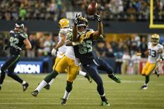Green Bay Packers cornerback Sam Shields (37, back) commits a holding penalty against Seattle Seahawks wide receiver Doug Baldwin (89, front) during the fourth quarter at CenturyLink Field. The Seahawks defeated the Packers 36-16. Mandatory Credit: Kyle Terada-USA TODAY Sports