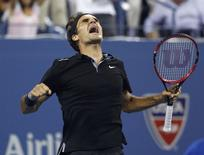 Roger Federer of Switzerland celebrates defeating Gael Monfils of France in the fifth set of their quarter-final men's singles match at the 2014 U.S. Open tennis tournament in New York, September 4, 2014. REUTERS/Mike Segar