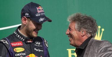 Red Bull Formula One driver Sebastian Vettel of Germany (L) talks to racing legend Mario Andretti after winning the U.S. F1 Grand Prix final at the Circuit of the Americas in Austin, Texas November 17, 2013.    REUTERS/Adrees Latif (UNITED STATES  - Tags: SPORT MOTORSPORT F1)
