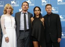 "Director Andrew Niccol (R) poses with cast members Ethan Hawke (2nd L),  Zoe Kravitz (2nd R) and January Jones during the photo call for the movie ""Good Kill"" at the 71st Venice Film Festival September 5, 2014. REUTERS/Tony Gentile"
