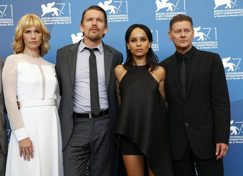 Director Andrew Niccol (R) poses with cast members Ethan Hawke (2nd L),  Zoe Kravitz (2nd R) and January Jones during the photo call for the movie ''Good Kill'' at the 71st Venice Film Festival September 5, 2014. REUTERS/Tony Gentile