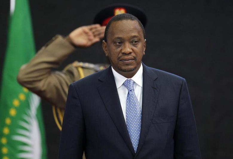 Kenya's President Uhuru Kenyatta stands for Kenya's national anthem before the Africa Union Peace and Security Council Summit on Terrorism at the Kenyatta International Convention Centre in Nairobi, September 2, 2014. REUTERS/Thomas Mukoya