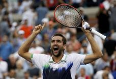 Marin Cilic of Croatia celebrates after defeating Roger Federer of Switzerland in their semi-final match at the 2014 U.S. Open tennis tournament in New York, September 6, 2014.           REUTERS/Mike Segar