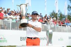 Sep 7, 2014; Cherry Hills Village, CO, USA; Billy Horschel winner of the BMW Championship holds a trophy at Cherry Hills Country Club.  Ron Chenoy-USA TODAY Sports