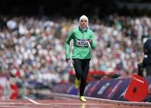 Saudi Arabia's Sarah Attar runs in her women's 800m round 1 heat at the London 2012 Olympic Games at the Olympic Stadium August 8, 2012. REUTERS/Lucy Nicholso