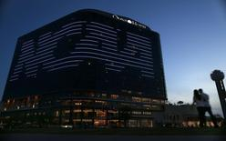 The NCAA logo is seen on the side of a hotel in Dallas, Texas, March 30, 2013. REUTERS/Jim Young