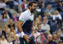 Marin Cilic of Croatia reacts as he holds serve in the third set against Kei Nishikori of Japan during their men's singles final match at the 2014 U.S. Open tennis tournament in New York, September 8, 2014.  REUTERS/Eduardo Munoz