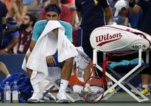 Roger Federer of Switzerland reacts during a break in the last set of the semi-final match against Marin Cilic of Croatia at the 2014 U.S. Open tennis tournament in New York, September 6, 2014. REUTERS/Mike Segar