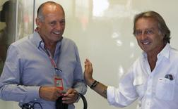 Ferrari Formula One CEO Luca Cordero di Montezemolo (R) gestures next to McLaren Formula One executive chairman Ron Dennis during the third practice session of the Italian F1 Grand Prix at the Monza circuit September 8, 2012.  REUTERS/Stefano Rellandini