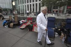 A man, dressed up as Colonel Sanders, walks outside the Apple Store in advance of an Apple special event, in the Manhattan borough of New York September 9, 2014.    REUTERS/Carlo Allegri