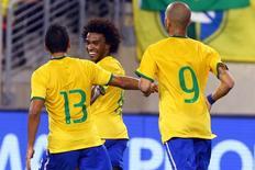 William comemora gol marcado em amistoso contra o Equador no estádio MetLife, em Nova Jersey, EUA. 9/09/2014. Ed Mulholland/USA TODAY/Reuters