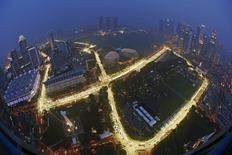 The Marina Bay street circuit is illuminated at dusk after a downpour in Singapore September 11, 2014. REUTERS/Edgar Su