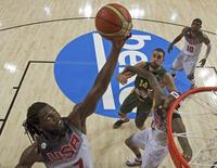 Kenneth Faried (L) of the U.S. grabs a rebound over teammate DeMarcus Cousins (12) and Jonas Valanciunas of Lithuania during their Basketball World Cup semi-final game in Barcelona September 11, 2014.  REUTERS/Gustau Nacarino