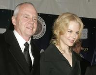 Actress Nicole Kidman is escorted by her father, Dr. Antony Kidman, as she arrives at the 2005 Palm Springs Film Festival Gala dinner in Palm Springs, California in this January 8, 2005 file photo REUTERS/Fred Prouser/Files