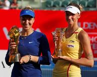 Winner Sabine Lisicki of Germany (L) and Czech Republic's Karolina Pliskova pose with their trophies after their Hong Kong Open women's singles final match September 14, 2014. REUTERS/Bobby Yip