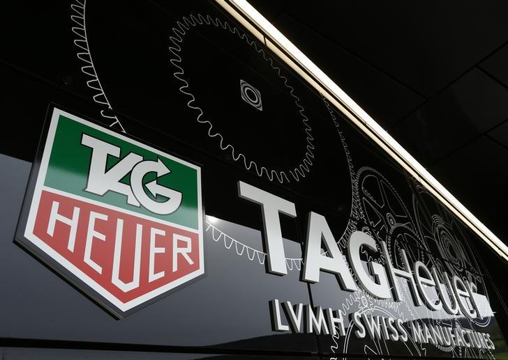 The Tag Heuer logo is seen at the entrance of their new watch manufactory in Chevenez November 5, 2013. REUTERS/Ruben Sprich