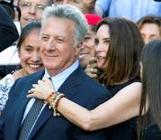 "Cast member Dustin Hoffman and his wife Lisa arrive for the premiere of the film ""Boychoir"" at TIFF in Toronto, September 5, 2014. REUTERS/Fred Thornhill"