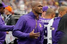 Dec 15, 2013; Minneapolis, MN, USA; Minnesota Vikings running back Adrian Peterson (28) talks on the sidelines during the first quarter against the Philadelphia Eagles at Mall of America Field at H.H.H. Metrodome. Mandatory Credit: Brace Hemmelgarn-USA TODAY Sports