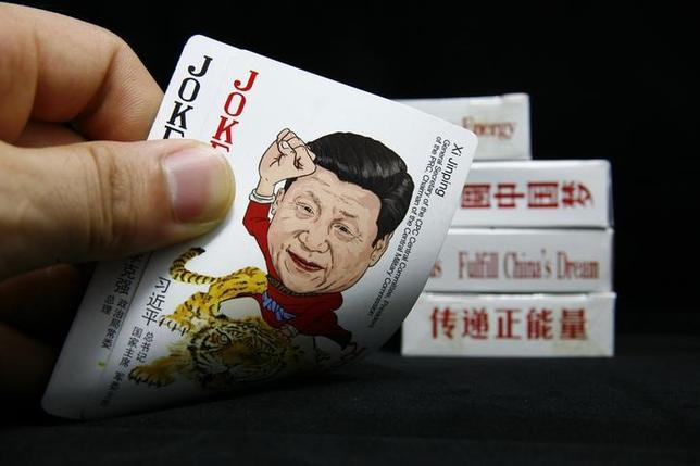 An image depicting Chinese President Xi Jinping is seen on the joker card of a set of cards featuring Chinese top political figures in this photo illustration taken in Beijing August 28, 2014. REUTERS/Karl Dong/Files