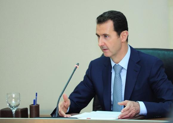 Syria's President Bashar al-Assad heads a meeting of his cabinet in Damascus August 31, 2014 in this picture released by Syria's national news agency SANA. REUTERS/SANA/Handout via Reuters