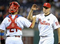 Sep 13, 2014; Philadelphia, PA, USA; Philadelphia Phillies relief pitcher Jonathan Papelbon (58) celebrates with catcher Wil Nieves (21) after the final out against the Miami Marlins at Citizens Bank Park. The Phillies won 2-1. Mandatory Credit: Eric Hartline-USA TODAY Sports