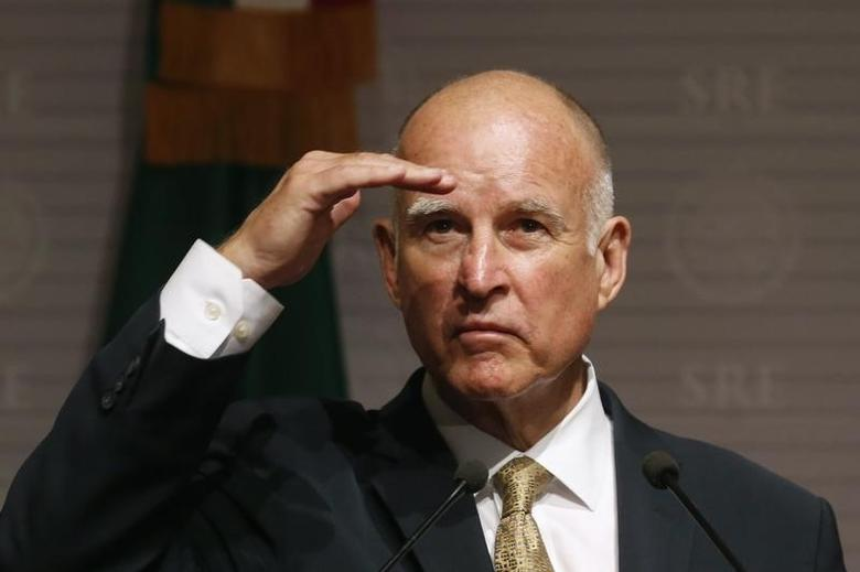 California Governor Jerry Brown gestures during a news conference at Memoria y Tolerancia museum in Mexico City July 28, 2014. REUTERS/Edgard Garrido