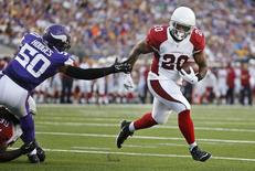 Aug 16, 2014; Minneapolis, MN, USA; Arizona Cardinals running back Jonathan Dwyer (20) runs with the ball around Minnesota Vikings linebacker Gerald Hodges (50) to score a touchdown in the first quarter at TCF Bank Stadium. Mandatory Credit: Bruce Kluckhohn-USA TODAY Sports