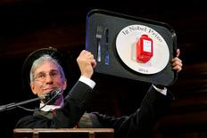 Marc Abrahams, Master of ceremonies and editor of the Annals of Improbable Research, holds one of this year's prizes at the 24th First Annual Ig Nobel Prizes awards ceremony at Harvard University in Cambridge, Massachusetts September 18, 2014.    REUTERS/Brian Snyder