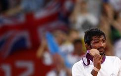 India's Yogeshwar Dutt poses with his bronze medal at the podium of the Men's 60Kg Freestyle wrestling at the ExCel venue during the London 2012 Olympic Games August 11, 2012. REUTERS/Grigory Dukor/Files