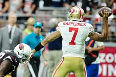 San Francisco 49ers quarterback Colin Kaepernick (7) throws the ball as Arizona Cardinals defensive end Frostee Rucker (98) tackles during the second half at University of Phoenix Stadium. Mandatory Credit: Matt Kartozian-USA TODAY Sports