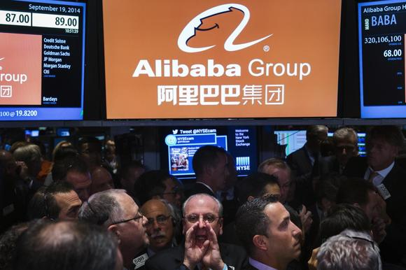 Traders work on the floor as they wait for a final price on the Alibaba Group Holding Ltd. initial public offering (IPO) under the ticker ''BABA'', at the New York Stock Exchange in New York September 19, 2014. REUTERS/Lucas Jackson