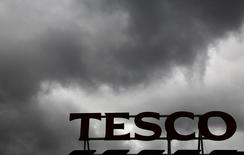 File photograph shows grey clouds hanging over a Tesco Extra store in New Malden southwest London June 4, 2014.  REUTERS/Luke MacGregor/Files