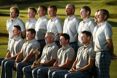 The European team line up for a photograph ahead of the 2014 Ryder Cup at Gleneagles in Scotland September 23, 2014. Back row (L-R) Victor Dubuisson, Jamie Donaldson, Ian Poulter, Henrik Stenson,Thomas Bjorn, Stephen Gallacher, Graeme McDowell and Sergio Garcia. Front row (L-R)  Justin Rose, Lee Westwood, captain Paul McGinley, Rory McIlroy and Martin Kaymer.    REUTERS/Phil Noble