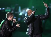 Eminem performs with Dr. Dre (R) at the 53rd annual Grammy Awards in Los Angeles, California, February 13, 2011. REUTERS/Lucy Nicholson