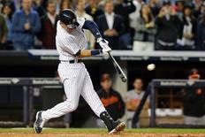 Sep 22, 2014; Bronx, NY, USA; New York Yankees shortstop Derek Jeter (2) hits a two-run double against the Baltimore Orioles during the fifth inning at Yankee Stadium. Mandatory Credit: Brad Penner-USA TODAY Sports