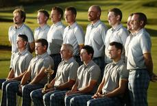 The European team line up for a photograph ahead of the 2014 Ryder Cup at Gleneagles in Scotland September 23, 2014. Back row (L-R) Victor Dubuisson, Jamie Donaldson, Ian Poulter, Henrik Stenson,Thomas Bjorn, Stephen Gallacher, Graeme McDowell and Sergio Garcia. Front row (L-R)  Justin Rose, Lee Westwood, captain Paul McGinley, Rory McIlroy and Martin Kaymer. REUTERS/Phil Noble (BRITAIN  - Tags: SPORT GOLF TPX IMAGES OF THE DAY)