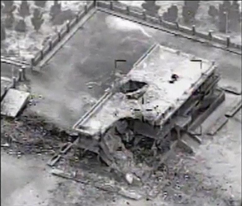 A still image taken from video provided by the U.S. Central Command shows a damaged building at an Islamic State (IS) compound near the northern Syrian town of Ar Raqqah, following an air strike against IS targets September 23, 2014.  REUTERS/U.S. Central Command/Handout via Reuters TV