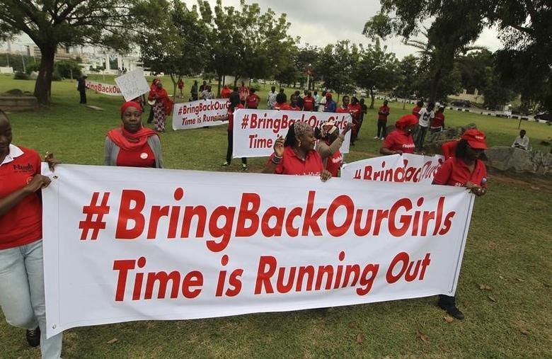 Demonstrators hold up banners during a rally that was held to mark the 120th day since the abduction of two hundred school girls by the Boko Haram, in Abuja August 12, 2014. REUTERS/Afolabi Sotunde