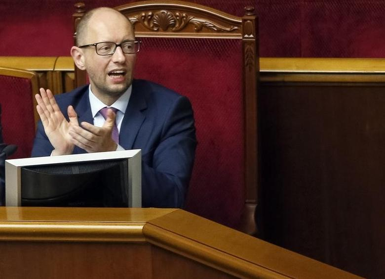Ukraine's Prime Minister Arseny Yatseniuk reacts during a session of the parliament in Kiev August 14, 2014.  REUTERS/Gleb Garanich