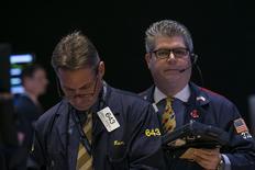 Traders work on the floor of the New York Stock Exchange September 22, 2014. REUTERS/Brendan McDermid